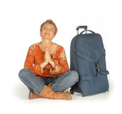 Woman sitting with suitcase on white Royalty Free Stock Photography
