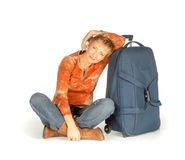 Woman sitting with suitcase on white Royalty Free Stock Photos