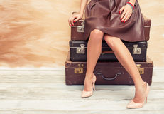 Woman sitting on suitcases Royalty Free Stock Image