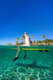 Woman sitting on a surfboard at ocean Stock Images