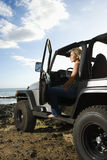 Woman Sitting in an SUV at the Beach Royalty Free Stock Photos