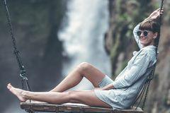Woman Sitting On Swing royalty free stock images