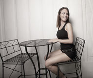 Woman sitting at a table Royalty Free Stock Photos