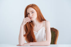 Woman sitting at the table royalty free stock photo