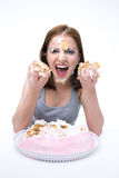 Woman sitting at the table with cake Royalty Free Stock Photos