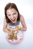 Woman sitting at the table with cake at her face Royalty Free Stock Photo