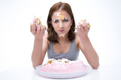 Woman sitting at the table with cake Royalty Free Stock Image