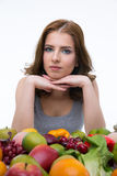 Woman sitting at the table with fruits Stock Photo