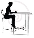 Woman sitting at the table Royalty Free Stock Images