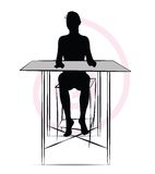 Woman sitting at the table Stock Photography