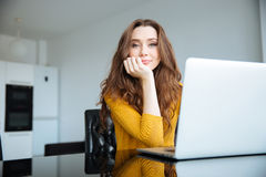Woman sitting at the table with laptop computer Stock Photo