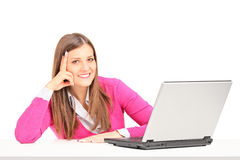 Woman sitting at a table with laptop Royalty Free Stock Photos