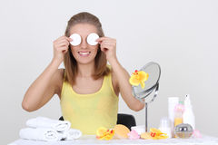 Woman sitting at table with make up accessories and mirror Stock Photo