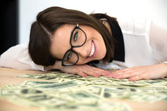 Woman sitting at the table with money Stock Images