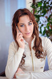 Woman sitting talking on the phone Royalty Free Stock Photo