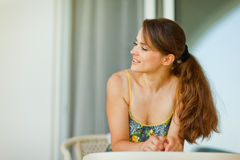 Woman sitting on terrace and looking on copy space Royalty Free Stock Image