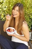 Woman sitting on the terrace with muesli. Outdoor Royalty Free Stock Photos