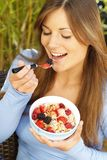 Woman sitting on the terrace with muesli. Outdoor Royalty Free Stock Photography
