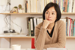 Woman sitting and thinking Royalty Free Stock Photo
