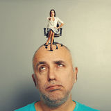 Woman sitting at tired man and pointing. Strict women sitting at tired men and pointing Stock Photos