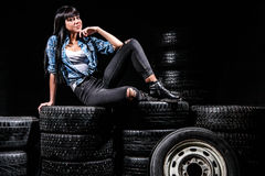 Woman sitting on a tires Stock Photos