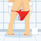 Woman Sitting On Toilet Royalty Free Stock Images
