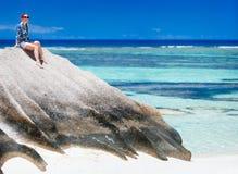 Woman sitting on top of granite rock Stock Image