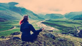Woman Sitting On The Top And Meditates Vintage Toned Instagram. Young Woman Sitting On The Top And Meditates Vintage Toned Instagram, Rear View stock images