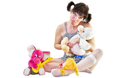 Woman sitting with toys Stock Photo