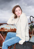 Woman sitting on a tractor Royalty Free Stock Image