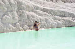Woman sitting in travertine pool in Pamukkale, Turkey Stock Photos