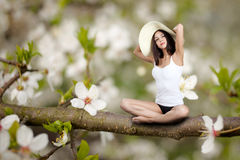 Woman sitting on tree Royalty Free Stock Photo