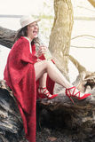 Woman sitting on tree with bottle of champagne Royalty Free Stock Photos