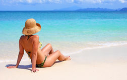 Woman sitting on a tropical beach. In the caribbean Stock Photography