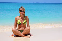 Woman sitting on a tropical beach Royalty Free Stock Photography
