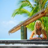 Woman in a tropical cafe Stock Photography