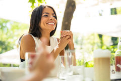Woman sitting a tthe table in outdoors restaurant Stock Photo