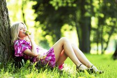 Woman sitting under tree Stock Photography