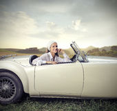 Woman sitting in a vintage car Royalty Free Stock Image