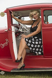 Woman sitting in a vintage car Royalty Free Stock Images