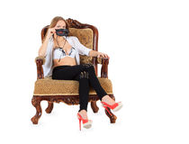 Woman sitting on the vintage chair Stock Photo