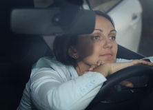 Woman sitting waiting in her car Royalty Free Stock Photos