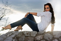Woman Sitting on Wall Royalty Free Stock Image