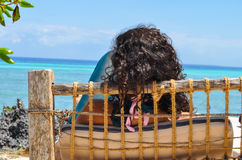 Woman sitting watching the sea Royalty Free Stock Photos