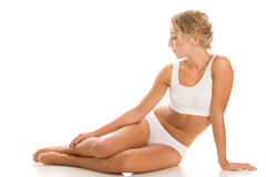 Young woman in underwear sitting on the floor stock photo