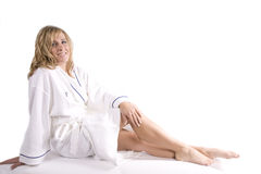 Woman sitting in white robe Royalty Free Stock Photo
