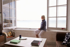 Woman Sitting At Window And Looking At Beautiful Beach View Royalty Free Stock Images
