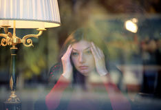 Woman sitting at the window and  meditate Royalty Free Stock Photo