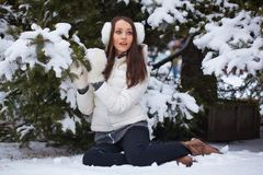 Woman sitting  in winter park Royalty Free Stock Photography