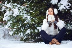Woman sitting  in winter park Stock Photography